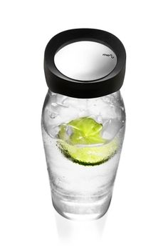 A plain glass carafe with distinctive, softly rounded, angular lines: A new, refreshing reinterpretation of the classic bottle archetype. The Menu Water Carafe has a protective steel collar and a lid that opens automatically when you pour from the carafe. The lid holds back ice cubes, lemon slices, etc., and provides unwanted objects from dripping down into the contents.