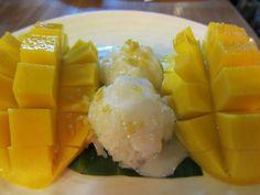 Thai Mango Sticky Rice. Sweet mango with warm soft sticky rice with coconut milk on top. Mmm....yum!