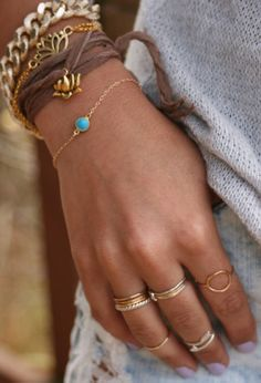 Layered bracelets and rings -makes a simple outfit so much more fun