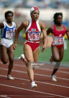 American track athlete Florence Griffith-Joyner competes in the heats of the Women's 100 metres event at the 1988 Summer Olympics inside the Olympic Stadium in Seoul, South Korea on September. Jet Shoes, Flo Jo, Track Meet, Vintage Black Glamour, Commonwealth Games, Olympic Sports, Sport Icon, My Black Is Beautiful, Summer Olympics