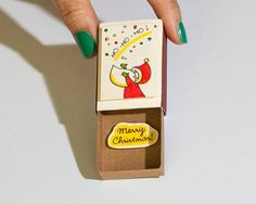 Cute Santa Christmas Card - Merry Christmas This listing is for one Christmas Holiday greeting matchbox. Each greeting matchbox is hand made from a real matchbox, and are a great way to send messages to your friends and loved ones. The designs are hand drawn, colored, printed on paper and