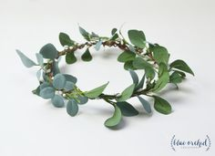 This beautiful, flower crown is filled with greenery and white berries. The base of the crown is wrapped entirely with cream/white, faux berries and gorgeous, green eucalyptus that has a slight blueish tint on one side of each leaf. This eucalytpus crown, is the perfect greenery