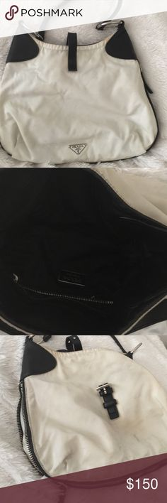Prada purse with cool zipper detail Prada purse - small/medium. Great purse. Has some discoloration. Strap is in great used condition. Could use a cleaning! Prada Bags Shoulder Bags