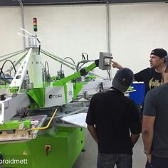 . @Regrann from @embroidmett -  Class is in session . @antic.screenprinting showing our team the ropes on our brand new #Roq automatic press. #embroidme #fullypromoted #trinidad #screenprinting - #regrann