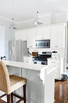 benjamin moore gray owl in a kitchen with white cabinets, lightened by 50 percent to be a soft light gray paint colour