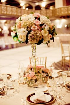 Tall Centerpiece with Small Votives of Flowers