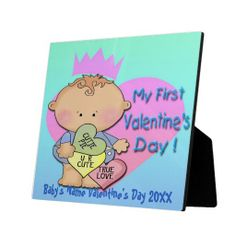 Boy My 1st Valentine's Day Plaque With Easel features a baby blue and green gradient background, a cartoon baby boy in front of a pink heart...