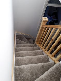 An all redwood staircase, featuring two single winders. Square spindles and newel posts were selected, finished with pyramid newel caps.