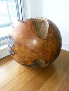 A natural accent for your home, this large size Teak Sphere polished to perfection is the perfect way to incorporate natural elements into your decor. Made of solid teak roots carved out of the ground, each sphere is considered unique and therefore one-of-a-kind.  #homedecor #livingroom #vintage #rustic