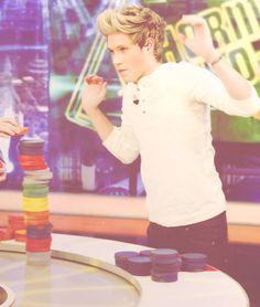 Niall raising the roof. Haha no idk what he's doing...