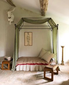 Lazy corner under the roof in Provence. Pair of wood and rope stools, Paired with an handmade canopy bed by Atelier Vime Éditions covered with Brigitte Singh's hand block printed « Chintz Buti Victorian Canopy Beds, Victorian Rooms, Victorian Terrace, Wrought Iron Bed Frames, Simple Bed, Vintage, Bedroom Decor, Interior Design, Furniture