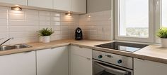 U Shaped Kitchen Design Ideas - There is A kitchen a kitchen layout that features three walls that are lined with appliances and cabinets. Kitchen Ideas Uk Small, Very Small Kitchen Design, Small Kitchen Lighting, Small Galley Kitchens, Small Kitchen Layouts, Small Kitchen Cabinets, Beautiful Kitchen Designs, Kitchen Photos, White Cabinets