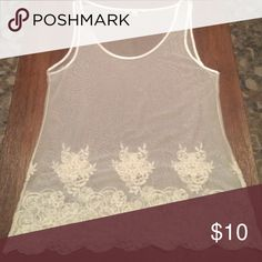 Sheer Decorative Banana Republic Tank Top Sheer cream tank top. This top is meant to be worn underneath another top or sweater with the decorative bottom showing. The bottom of the tank top has a decorative lace floral pattern. Made of: nylon and cotton. Banana Republic Tops Tank Tops