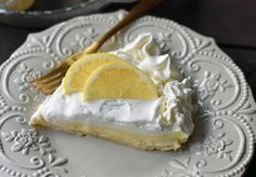 Sweet Lemon Sour Cream Pie made with freshly squeezed lemon juice, sugar, eggs, and sour cream to make it rich and creamy. All topped with homemade whipped cream in a buttery, flaky crust. A Marie Callender's Sour Cream Lemon Pie Copycat Recipe. www.modernhoney.com