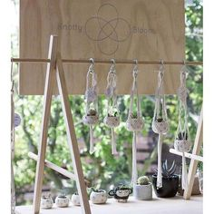 Display fixture idea to sit on top of a craft show table and add hanging space