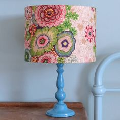 A beautiful, handmade lampshade in a bold floral print with a hint of the East and a vintage vibe.This lampshade can be used with pendant or lamp base fittings. I try to represent colours as accurately as possible but they may vary slightly from monitor to monitor. I'm more than happy to send out a fabric swatch in advance of purchase if this is a concern.This gorgeous fabric has a vintage feel to it and adds real warmth to a scheme. Big blooms in shades of teal, green, pink and yellow on a…