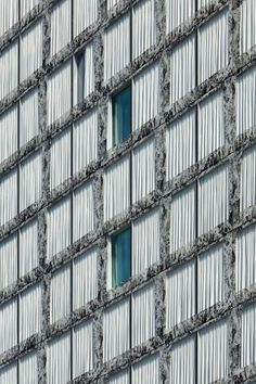 Office complex in Zurich featuring glass fritted facade to reference Mies' Barcelona Pavilion