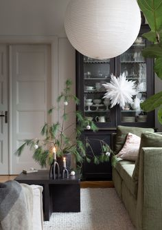 Simple yet elegant holiday decor does the trick according to My Scandinavian Home | the dark green moody corduroy sofa sets the scene for this minimal yet festive look | Seen here: a Bemz / Apartment Therapy Corduroy cover in Winter Moss for an IKEA Stockholm 3.5 seater sofa