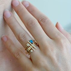As Summer approaches, beachy dreams drift into our heads like the sweet aromas of coconut oils and frangipanes, and couldn't help but inspire the Sydney stack! This ring stack is the ideal mix of linear shapes, twinkling diamonds and organic, watery blue Australian Boulder Opal. Four shiny and matte 14K yellow gold rings stack effortlessly to create a chic everyday jewelry look perfect for summer days.