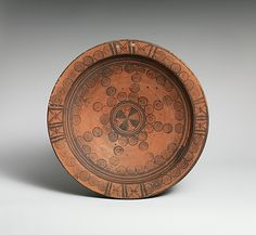 Plate Period: Cypro-Archaic I Date: ca. 750–600 B.C. Culture: Cypriot Medium: Terracotta