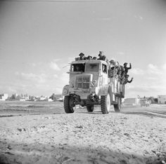 A lorry carrying infantry leaving the outskirts of Tarhuna during the advance towards Tripoli, 25 January 1943.