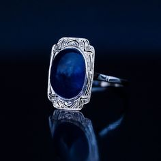 One of a kind French Art Deco c.1925 engagement ring features a cabochon cut midnight blue sapphire set in an openwork bezel embellished with rose cut diamonds. #artdecoring #artdecoengagementring #artdecojewelry #vintagering #vintagerings #vintagejewelry #vintagejewellery #cabochon #cabochons #sapphirering #engagementrings #vintageengagementring #frenchjewelry #jewelrydesign #jewellerydesign #jewelrydesigner #jewelryartist #statementring #statementrings #statementjewelry…