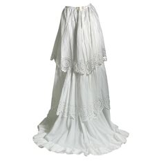 1870s French embroidered linen petticoat with train and flounces