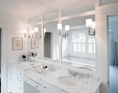 Love the mirrors, counters! dual bathroom vanities, connected in the center