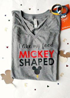 I LIKE MY FOOD MICKEY SHAPED in GREY on a V-NECK shirt. Ready to ship in 5-7 business days. HOW DOES IT FIT?---> This shirt is a Miss fit