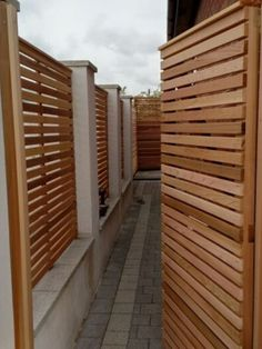 Compliment your contemporary garden boundary with the stunning Slatted Cedar Gate, perfect for lovers of modern taste. Wooden Garden Gate, Garden Gates And Fencing, Fence Gates, Gates Driveway, Fences, Contemporary Fencing, Contemporary Design, Modern Design, Cedar Gate