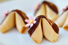 Fortune cookies dipped in chocolate with a gum paste flower as a wedding favor. Make custom fortunes!