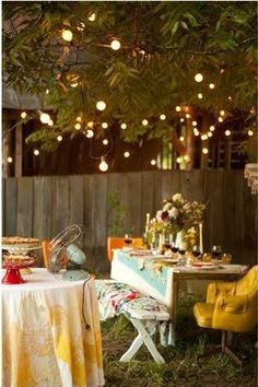 charming set for a backyard party- especially love the table setting and lights