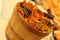 cute presentation of sweet potato fries in paper cones for a passed appetizer