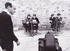 "Filming a trailer for A Hard Day's Night with Dick Lester at Twickenham Film Studios, 3 April 1964 I love Lewisohn's comment on this so I'm typing it up.""[A] bizarre sequence in which John/George and Ringo/Paul sat in two adjacent baby prams,their legs dangling over the sides. John typed, Paul spoke, George mumbled and Ringo twice answered a telephone saying ""It's for you, John,"" to which John twice replied, ""Don't be soft."" Quite ho..."