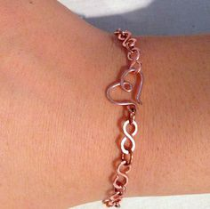 Infinity Link Copper Bracelet with Heart Clasp von NotAMona auf Etsy, $28.00