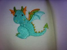 Baby vest with baby dragon, £5 on its own or £6-£7 with a name :)