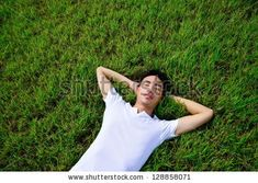 Young man doing yoga in park. Healthy lifestyle.