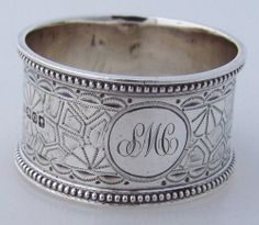Silver monogrammed napkin rings