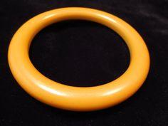 Bakelite yellow bangle bracelet. Mod style bangle bracelet in an eye catching yellow, modern meets mod in this hip bakelite piece.