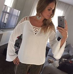 Earrings set off this stunning Boho Chic White Patchwork Cut Out Round Neck Fashion Blouse