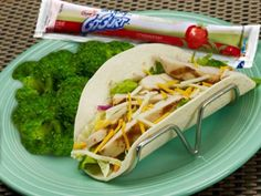 Tony Roma's Chicken Taco - A flour tortilla filled with all-natural grilled chicken breast, Asian salad mix and cheese blend. Served with Go-Gurt frozen strawberry yogurt and broccoli.