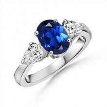 Lab Created Oval Sapphire and Simulated Pear Diamond Three Stone Ring