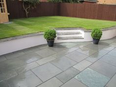 slate garden tiles top of wall Garden Slabs, Slate Garden, Slate Patio, Garden Retaining Wall, Garden Tiles, Garden Paving, Patio Wall, Small Retaining Wall, Landscaping Retaining Walls