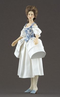 NAME: Antonine - PERIOD: 1770-1780. Woman in undergarments from the end of the 18th century, with shift and pocket side panniers. The corset silk fabric was printed by Les Chinoiseries exclusively for Carabosse Dolls, based on patterns from that period.