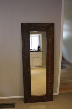 We've had this full length mirror without a frame for a while. After living behind our bedroom door propped up against the wall we finally ...