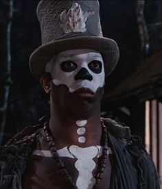 Voodoo man from James bond film 'Live and let Die.' Another reference to a top hat being depicted as a statement for a zombie/voodoo man to wear.