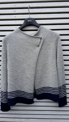 This simple raglan cardigan deserves to be a staple in every knitter's wardrobe. Worked in one piece from the top down, the sweater features reversible front borders and elegant shaping. Faux raglan, back and doubled side seams add visual interest. The optional longer sleeves include thumb openings which make the cuffs function like built-in fingerless mitts - perfect for those cooler days!