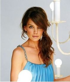 Back combed top section, side sweeping fringe and curled side ponytail