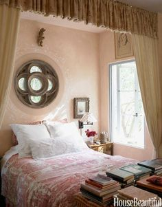 Bianchi used her favorite fabric, an 18th-century dark pink and white toile, to serve as the bedspread.