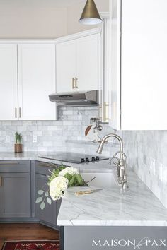 Gray and white cabinets, marble subway tile, Carrara countertops, a farmhouse sink, and brass hardware give this marble kitchen a classic yet modern look. ** Click on the image for additional details. #homedecor